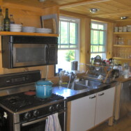 Kitchen area, Bosch gas stove and stainless steel sink and Bosch dishwasher