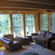 Cherry Dip Cottage Living Room area with large glass windows.